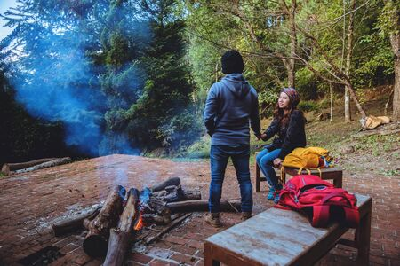 Couple travel photograph nature on the mountains relax in the holiday. Romance lovers Camp Fire winter