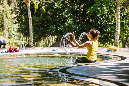 Girl in a pool hot spring in Thailand,Natural Mineral Water,Hot Springs In National Park,Hot Spring nature travel