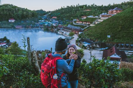 Couple Asian traveling together on mountain in Ban Rak Thai village countryside. Travel, camping in the winter, Outdoor relaxation, Romantic couples.