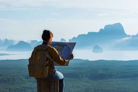 Travelers, young women are exploring the map. Landscape Beautiful Mountain on sea at Samet Nangshe Viewpoint. Phang Nga Bay ,Travel adventure, Travel Thailand, Tourist on summer holiday vacation.