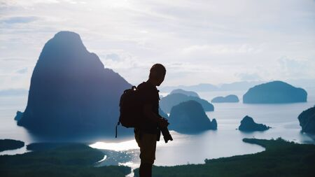 Men travel photography on the Mountain. Tourist on summer holiday vacation. Landscape Beautiful Mountain on sea at Samet Nangshe Viewpoint. Phang Nga Bay , Travel Thailand, Travel adventure nature.