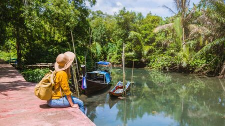 Asian woman travel nature. Travel relax.a boat photo. Sitting watching the beautiful nature at tha pom-klong-song-nam. Krabi, in Thailand. Stock fotó