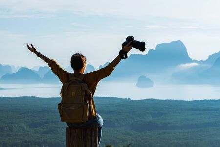 Female tourist photographers travel on the mountain. Landscape Beautiful Mountain on sea at Samet Nangshe Viewpoint. Phang Nga Bay ,Travel adventure, Travel Thailand, Tourist on summer holiday vacatio