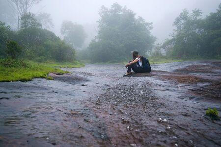 Girl walking traveling adventure nature in the rain forest. travel nature, Travel relax, Travel Thailand, rainy season. (Phu Hin Rong Kla National Park)