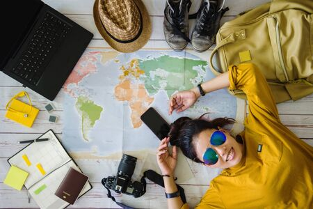 Travel planning concept with map. Overhead view of equipment for travelers. Background travel ideas young women sleeping smiling on the map. concept on vacation trip, map, Travel Thailand.