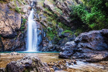 Natural background Landscape photo jogkradin in the deep forest at Kanchanaburi in Thailand. Emerald waterfall, travel nature, Travel relax, Travel  Thailand, Waterfall picture, Landscape photo. 스톡 콘텐츠 - 127422908