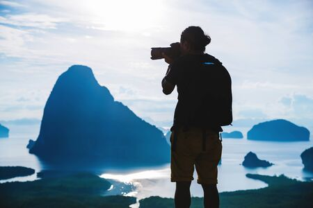 Men travel photography on the Mountain. Tourist on summer holiday vacation. Landscape Beautiful Mountain on sea at Samet Nangshe Viewpoint. Phang Nga Bay, Travel Thailand, Travel adventure nature.