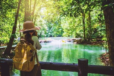 The girl travel take a photo of the Than Bok Thorni Waterfall National Park. lake, mangrove forest. travel nature. Travel relax. travel Thailand, backpack, style, forest, summer.