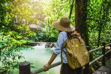 women travel relax nature in the holiday. Nature Study in the forest. The Girl happy walking and enjoying Tourism in through the mangrove forest. Waterfall Than Bok Khorani Nature Trail. travel, backpack. Stock fotó