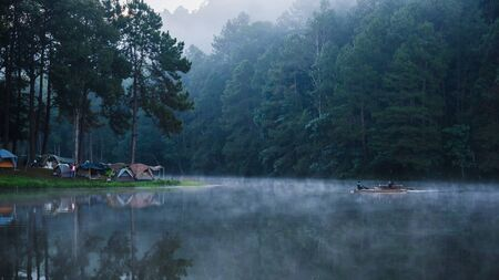 camping and travel  Beatiful nature panorama view of Pang Ung lake in the mist at sunrise.