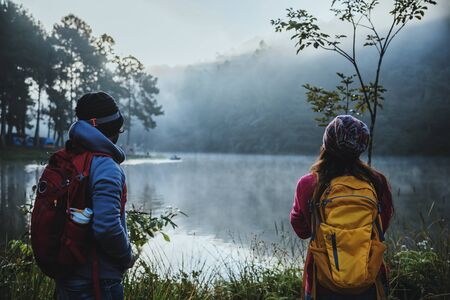 Couple lovers travel Beatiful nature at Pang ung lake and pine forest at Mae Hong Son in Thailand.