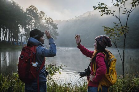 Couples who love to travel, take pictures Beatiful nature at Pang ung lake and pine forest at Mae Hong Son in Thailand.