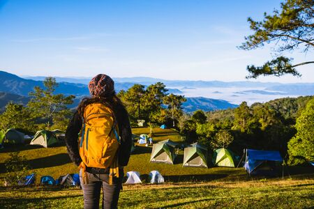 Young woman Tourists with backpacks Travel nature landscape view on the mountain, Backpacker Camping Hiking Journey Travel Trek Concept.