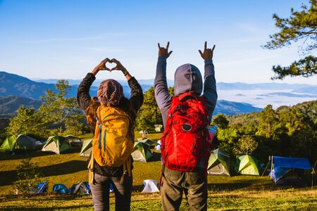 Young couple Backpacker Camping Hiking Journey Travel Trek Concept, Holiday travel, summer in Thailand.