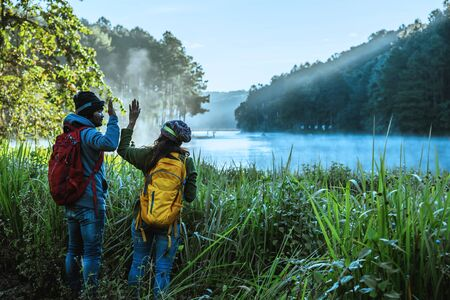 Couples asian Travel, take pictures of nature landscape the beautiful at Pang Ung lake, Thailand.