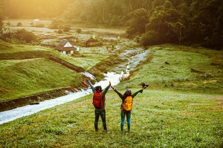 Couples asian Travel, take pictures of nature landscape the beautiful sunrise at Pang-ung.