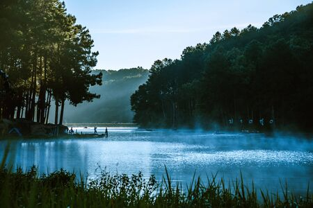 A beautiful landscape with fog floating on the lake surface in the sunrise at Pang-ung.