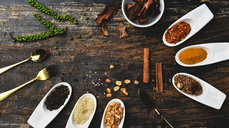 Various colorful herbs and spices on wooden table. Top view of spices and herbs. Spices and herbs over on wooden table background. 版權商用圖片