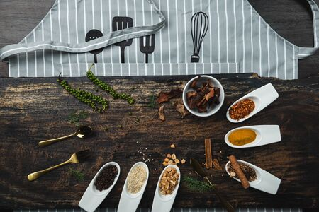 Various colorful herbs and spices on wooden table. Top view of spices and herbs. Spices and herbs over on wooden table background. Stock fotó