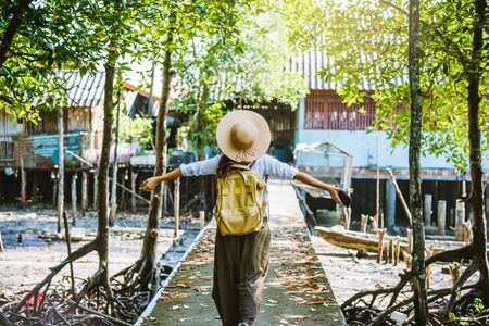Asian woman travel nature Walk and watch the way of life of the villagers in rural villages fisherman. tourism, summer, lake, holiday, travel Thailand. backpack, Nature, Travel, holiday Stock fotó