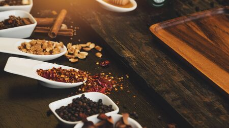 Various colorful herbs and spices on wooden table. Top view of spices and herbs. Spices and herbs over on wooden table background. Фото со стока