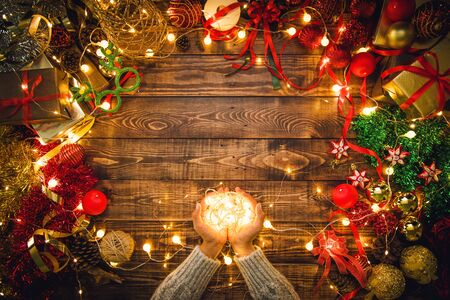 Christmas composition. Gifts, fir tree branches, decorations on a wooden background with copy space for your text. Christmas, winter new year concept. Led lights 写真素材