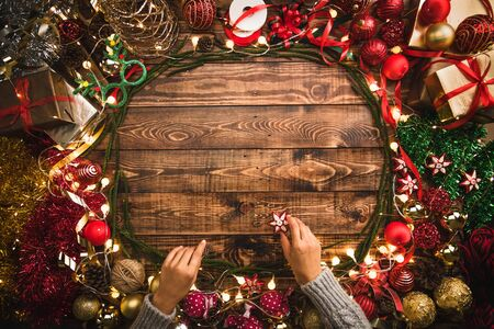 Christmas greeting card.Christmas flat lay composition, holiday decorations, Christmas tree gifts on the wooden background with copy space for your text. 写真素材