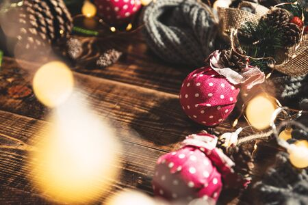 Merry Christmas and Happy New Year. Christmas composition. Gifts, fir tree branches, ball red decorations on a wooden background with copy space for your text. Christmas, winter new year concept. Led  写真素材