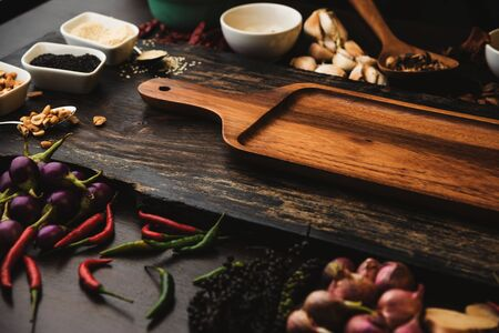 Healthy food herbs Spices for use as cooking ingredients on a wooden background with Fresh organic vegetables on wood. High dietary fibre health smart food concept.