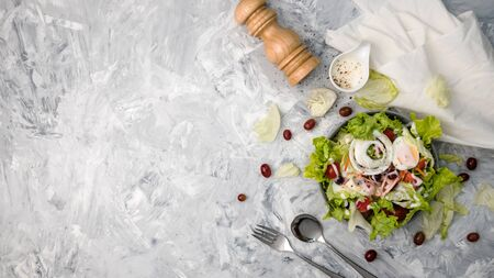 Concept for a tasty and healthy vegetarian meal. Top view Greek salad on stone background. vegetable organic Salad.