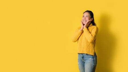 Image of beautiful cute young girls smiling and happy isolated over yellow background. space to copy the text 스톡 콘텐츠