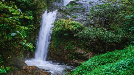 Travel the highest waterfall in Chiangmai Mae-pan waterfall rainy season forest at Doi intanon. background waterfall.