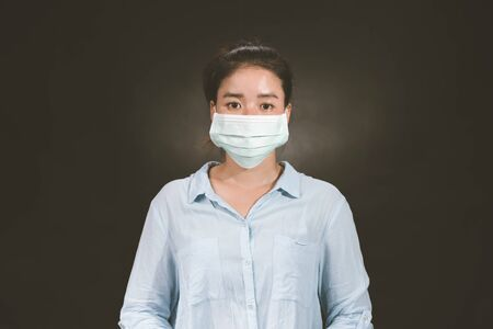 Asian woman wearing protection face mask against coronavirus. antiviral medical mask for protection against flu diseases. Surgical mask. corona virus disease. COVID-19 Banco de Imagens