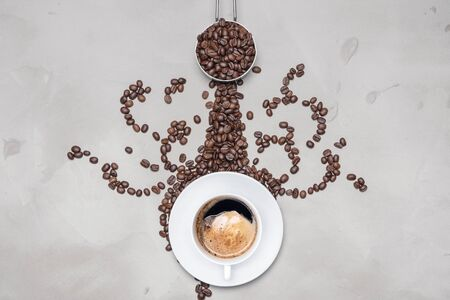 Cup of coffee black with coffee beans on a white background with copy space for your text Banco de Imagens