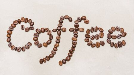 the word coffee is made of coffee beans.On a white background. copy space word  coffee