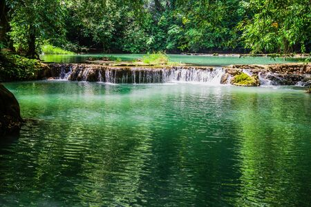 Natural background waterfall. Waterfall Emerald Pool, beautiful deep forest waterfall in Thailand