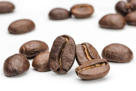 Set of fresh roasted coffee beans isolated on white background. Coffee beans close up, Espresso dark