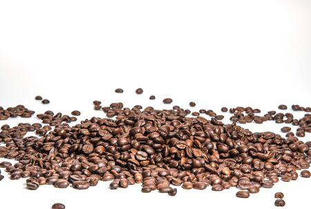 coffee beans roasted on a white background with copy space for your text
