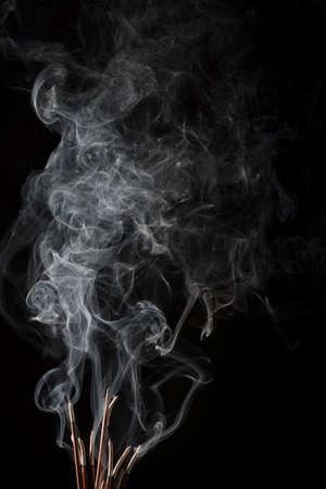 Smoke isolated on black background. Movement of white smoke
