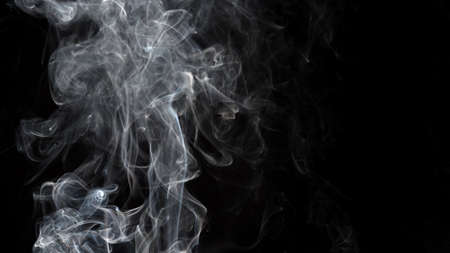Smoke isolated on black background. Movement of white smoke