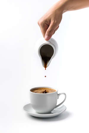 pouring a cup of coffee over white background