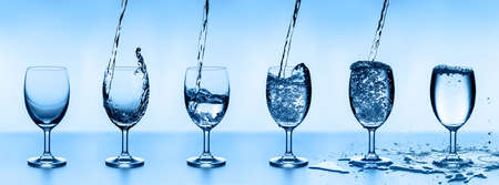 six water glasses of water, arranged in ascending order. Stock fotó