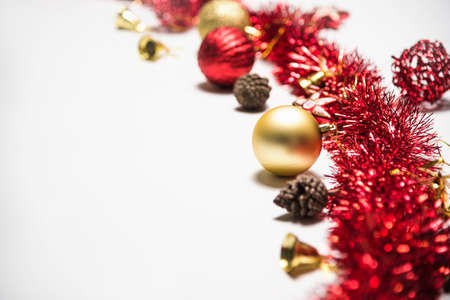 Christmas decoration balls and ornaments over abstract bokeh background on white background. Holiday background greeting card for Christmas and New Year. Merry Christmas
