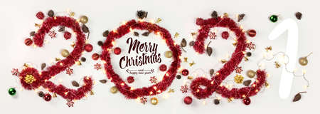 New Year 2021. Christmas. Holidays. Composition with Christmas and New Year garlands, numbers 2021
