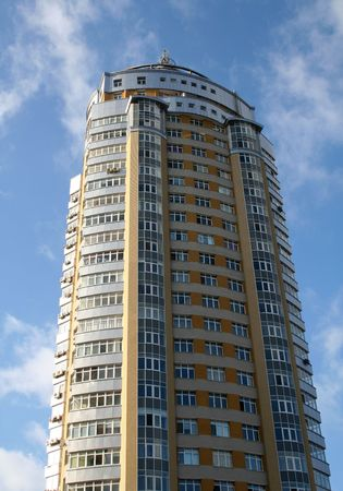 modern tall yellow building with balconies under cloudy sky Stock Photo - 2516072