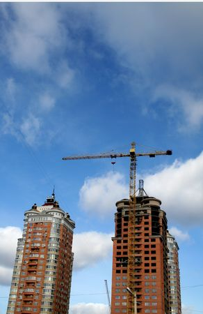 elevator operator: yellow crane and two orange tall buildings