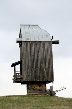 histories: traditional ukrainian wooden windmill without blades