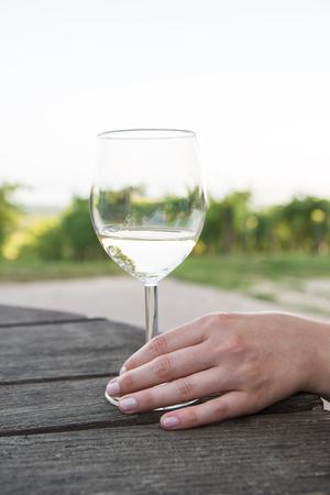 Girl drinks white wine in Balaton Wine region, Hungary