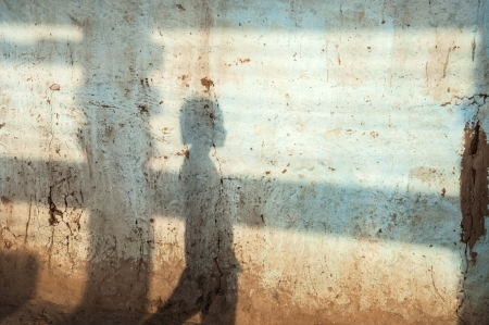 bodhgaya: Girl shadow on a wall in Bodhgaya