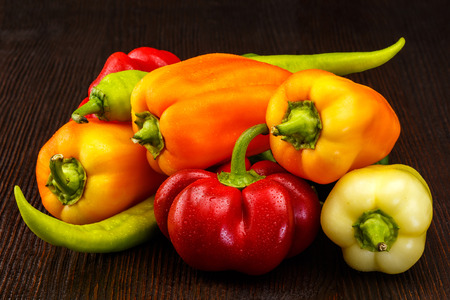 organic peppers: Variety of fresh organic peppers on the table